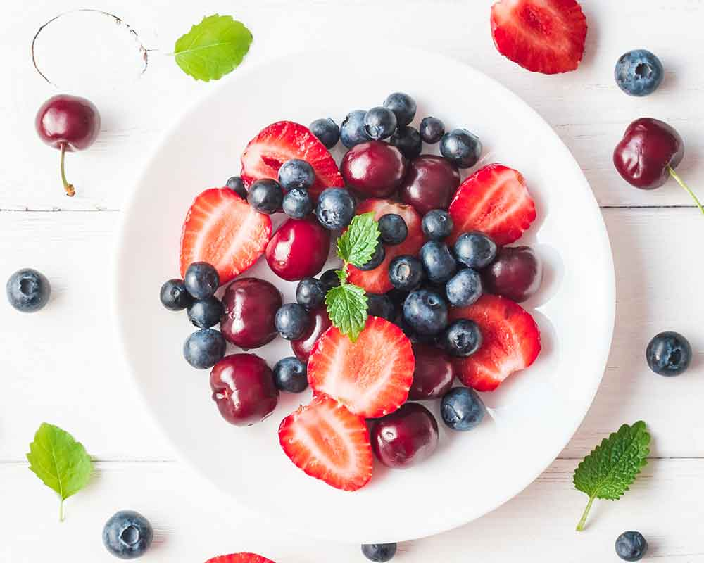 mixed berries on a white plate