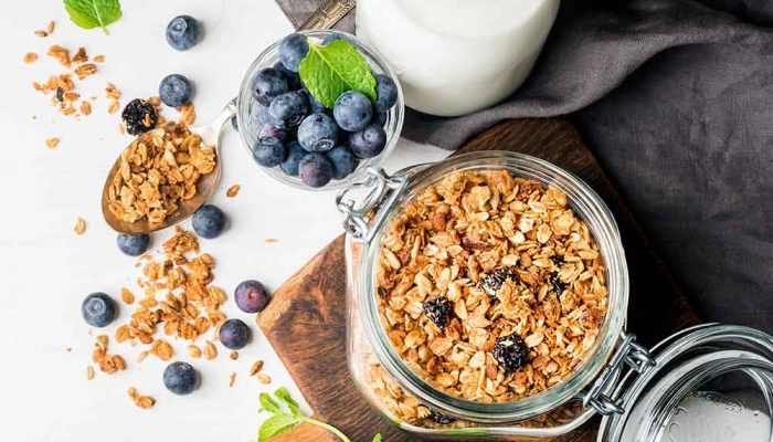 oats in a glass jar, blueberries and a bottle of milk
