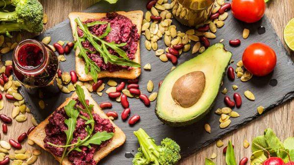 vegetarian and vegan food on a black chop board