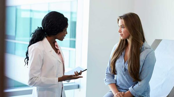 Nurse talking to the patient