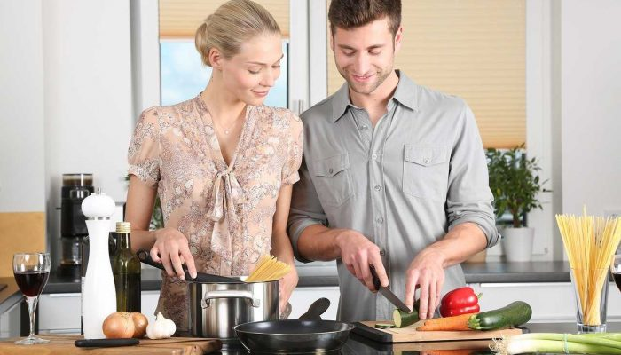 couple preparing a hearty meal together
