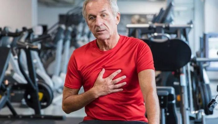 Ascites-Holder guy in the gym having chest pain