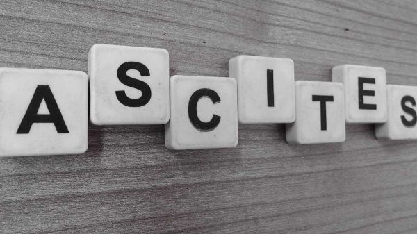 tiles with letters formed a word ascites