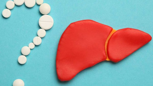 pills formed in question mark and a human liver