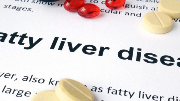 Fatty liver disease text and assorted pills