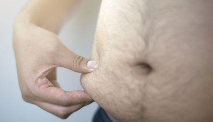 man showing big stomach