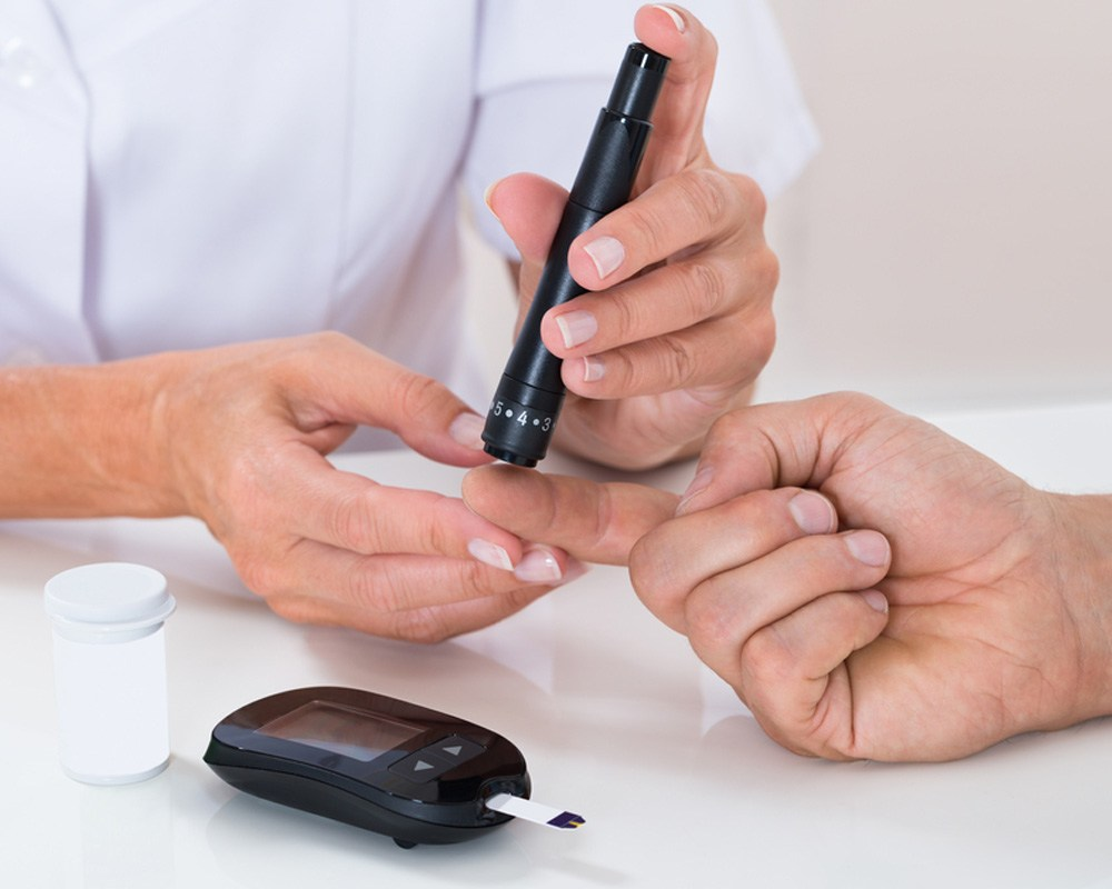 Checking blood sugar with with glucometer