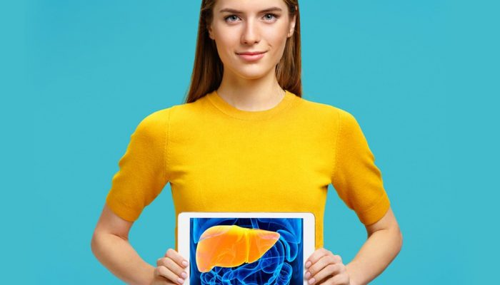 woman holding a picture of human liver