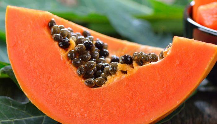 A slice of fresh papaya fruit
