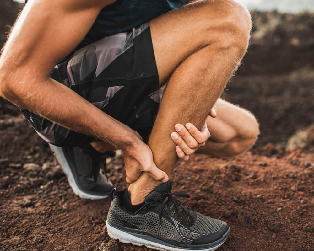 Athlete Suffering From Tendonitis