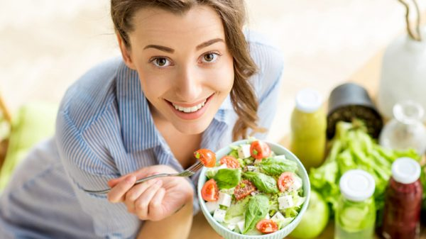 Woman eating vegan salad